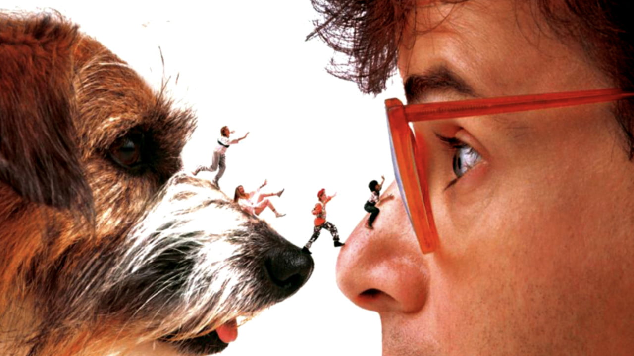 Shrunken kids walk over a dog's nose onto a human's nose. It was the 90s.