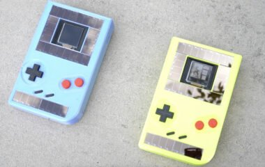 Two solar-powered Game Boys, one blue and one yellow