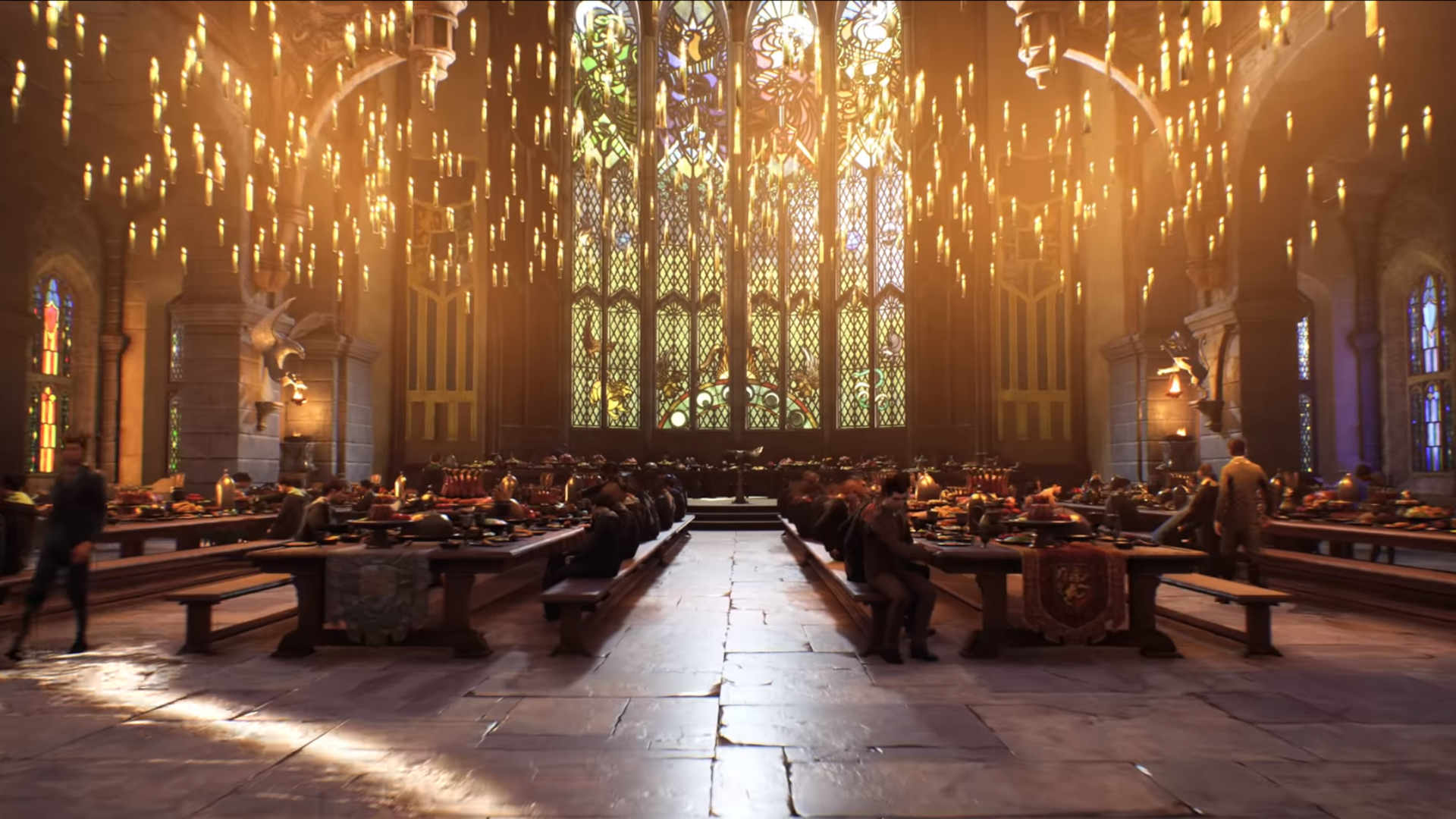 Students sitting in the main hall of Hogwarts
