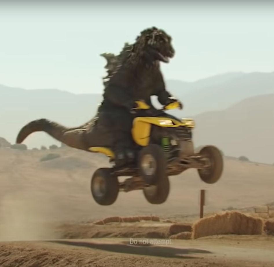 Godzilla rides an ATV
