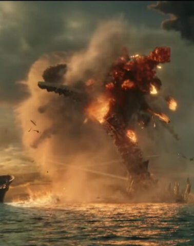 Godzilla's tail rises from the water