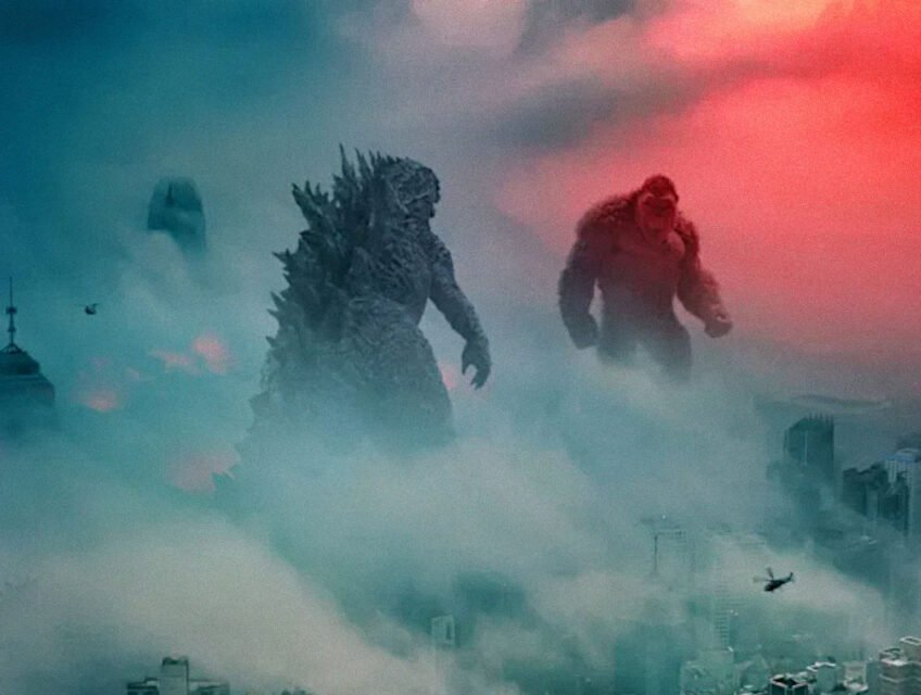 Godzilla and Kong face off over a misty city