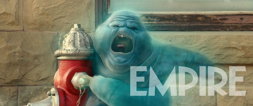 The angry and fat blue ghost Muncher from Ghostbusters: Afterlife hugs a fire hydrant